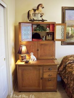 Hoosier Cabinet...like how it used as a side table in bedroom.