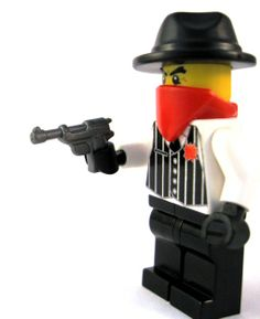 So it's pretty hard to put a Christmas twist on a blog post about a custom Lego gun.  BUT I did make sure to pick a picture of a gangster minifigure wearing a red bandana…can't you tell he's in the holiday spirit?!  Anyways, this week's custom Lego gun is the German 38.  It's perfect for your gangster minifigs and no classy German officer would be caught with any other sidearm! #Lego #minifigures #BrickWarriors #guns #weapons #gangsters #army #war #battle