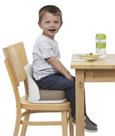 """OXO Tot Perch Booster Seat For Big Kids: Still need a boost to reach the dinner table, but way beyond highchairs? We love this sleek portable booster, which folds compactly and offers """"big kid"""" style. Very comfortable, with a 3"""" thick cushion and contoured backrest. Folds for travel, with built-in handle for easy carrying..."""