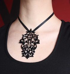 Acryl filigree laser cutted key hole steampunk pendant tattoo style gothic necklace. $13.00 USD, via Etsy.