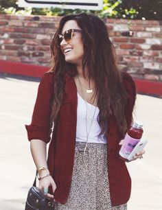 super cute outfit! dark red cardigan, floral skirt