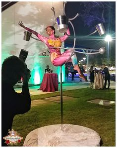 Our Lollipop Lyra can be set up to serve champagne to your guests! Let us and a talented aerialist add that extra something special that's sure to wow your guests at your next event! Lollipop Lyra, Aerial Server, Aerial Bartender, champagne, live entertainment, J&D Entertainment, www.jdentertain.com, interactive food beverage service, cirque