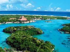 Xel-Ha eco park, Riviera Maya, Mexico. This place is amazing! Bike paths, float down a mangrove river, cliff dive, snorkel, hike or just lounge. Food and drink (even alcoholic) included. This was a truly memorable experience. I would go back in a heartbeat.