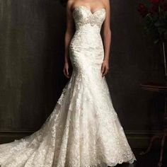 Beautiful lace trumpet wedding gown...not crazy about lace style but gown is pretty
