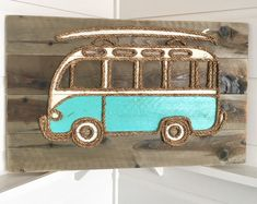 A replica of the original 21 window VW bus, this piece adds a bit of California surf culture to any room! Dimensions: All artwork is signed, branded on back-side and shipped ready to hang. Ocean Crafts, Beach Crafts, Glue Crafts, Wood Crafts, Mermaid Tile, Pebble Art Family, Beach Cottage Style, Beach House, Yarn Wall Art