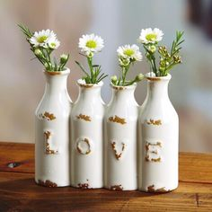 Put L-O-V-E anywhere in your home! Antique-finish ceramic mini bottle vase has 4 openings for faux or fresh flowers | Love Mini Vase $7.00