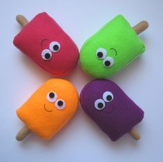 Cheerfully colourful summertime felt food popsicles.