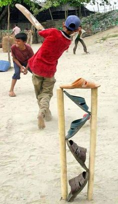 A bunch of kids somewhere in India get around a paucity of stumps quite ingeniously.