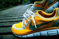Let her customize her own pair of Nikes, like these NIKE ID FREE 5.0 DEL SOL. http://nikeid.nike.com/nikeid/index.jsp