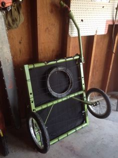 Diy bike trailer,sewn canvas deck with hand riveted eyelets and built in space underneath for a spare