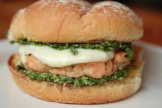 My daughter has been after me since last summer to make these salmon  burgers, and for the life of me I don't know why I waited so long.  If you  love salmon like I love salmon, you will definitely love a salmon burger.   This one is terribly decadent with the addition of basil pesto and  mozzarella cheese.  Oh, man.  Salmon patties are available in the freezer section of most markets, I  think, but I made my own using Mark Bittman's recipe.  They are just  killer.  I also made my own…