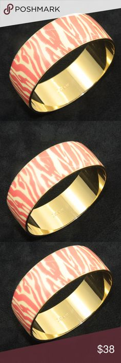 J. Crew Bangle Bracelet J. Crew Bangle Bracelet.  1 inch tall. Round.  Gold tone with cream and pink enamel.  Used item: any wear shown in pictures.  Excellent condition!   Bundle Up!  Offers always welcome : ) J. Crew Jewelry Bracelets