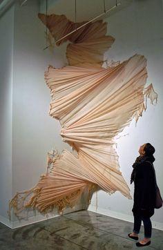 carlie trosclair pours fabric down walls.