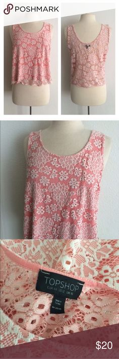 """Topshop pink top Topshop pink lace top. Size 12. Measures 22"""" long with a 40"""" bust. This has a bit of stretch to it. The body is 52% polyester/ 48% polyamide and the lining is 100% viscose. The back is sheer. EUC. **This is the same top worn by Daphne on Switched at Birth!  🚫NO TRADES🚫 💲Reasonable offers accepted💲 💰Ask about bundle discounts💰 Topshop Tops Tank Tops"""
