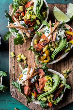 Salmon Fajita Salad Boats | salmon, red bell pepper, poblano, mango, jalapeno, romaine, taco shells, cheddar, avocado