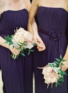 Basing bridesmaids bouquets on this, adding accent plum/purple to compliment dress