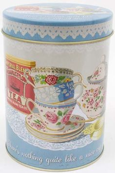 """""""Nice Cup of Tea"""" Storage Tin at BBC Shop """"There's nothing quite like a nice cup of tea."""" Put the kettle on and treat yourself to warm, soothing refreshment. This air-tight tea tin, decorated with rose-covered English teacups, teapot, tea strainer, tea tin and lace doily is the perfect place to store tea bags, loose-leaf tea or household odds and ends."""