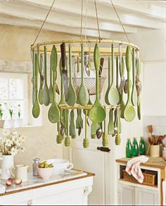 Kitchen Light made from utensils. Links to site that is in French.-i see wooden spoons and honey dippers!