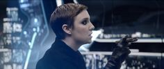 Lena Dunham appeared briefly in some leather gloves and heavy eye makeup.