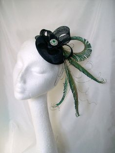 Navy Blue Turquoise Peacock Sword & Sinamay Loop Rhinestone Fascinator Cocktail Hat £35.00 Order Now from www.indigodaisyweddings.co.uk Specialising in stunning bespoke cocktail fascinators and formal hats in a wide range of colours, perfect for Royal Ascot and The Kentucky Derby. Plus all your wedding floral accessories including shoe clips, vintage flapper bands, feather and flower fascinators, feather fans, fairy wands, wrist corsages, wedding bouquets & buttonholes. Worldwide Delivery.
