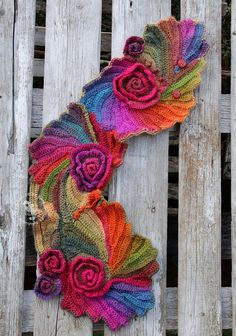 Winter crochet scarf Christmas gift For her. Unique crochet scarf made Freeform method. Warm and pleasant to the touch. Beautiful unique design . Color: rainbow One of a kind. Size: One size fits all Irregular shape approx: 98/20-27 cm 38,58/7,87-10,63 materials used: 30%wool, 70% acrylic