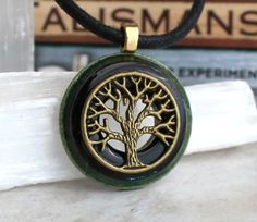Black and brass tree of life necklace