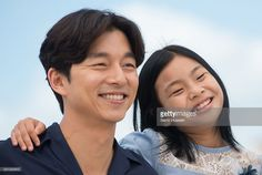 Gong Yoo and Kim Su-an attendsthe 'Train To Busan (Bu_San-Haeng)' Photocall at the annual 69th Cannes Film Festival at Palais des Festivals on May 12, 2016 in Cannes, France.