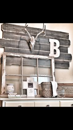 Rustic Neutral Nursery Design with Aged Cedar Fence slats, Chippy Window, Deer Antlers, and a Large Initial on the wall...