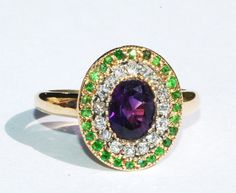 Suffragette Ring, circa 1910, set with demantoid garnets, amethysts and diamonds.