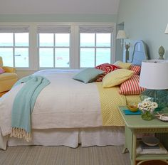 Triad colors-The colors that make this room a triad color scheme bedroom are Blue, red and Yellow.