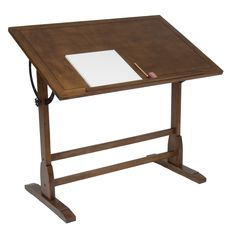 The classic design of this vintage drafting table is reminiscent of turn-of-the-century furnishings. This gorgeous table features ample work space on elegantly distressed wood.