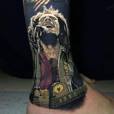 A fucking Tat of Bob Marley Singing, Sick shit, good job Man! ! Jdizz