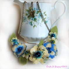 Cottage Chic Yellow and Blue Pansy Necklace by CraftyJoDesigns https://www.etsy.com/uk/listing/219396453/flower-necklace-cottage-chic-yellow-blue?ref=shop_home_active_1