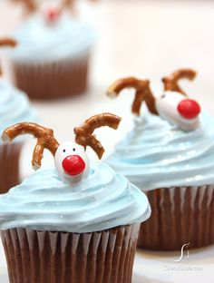 Chocolate with Vanilla Cream Reindeer Cupcakes....decorated with Jordan almonds, Red Hot candies and pretzel antlers!