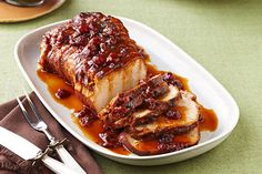 Cranberry sauce and the juice and zest of an orange work their tasty magic in the slow cooker so you can come home to a sweet and tart roast pork loin.