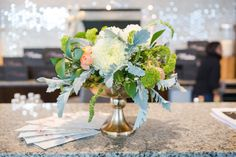 Lanson B. Jones Floral + Events | Megan Chandler floral designer | #macfloraldesigns | Mostess Launch Party | peach green and ivory centerpieces
