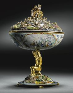 Southern German, Augsburg, circa 1600 THE ROTHSCHILD ORPHEUS CUP with a torn paper label underneath: Baron L. Rothschild partially enamelled gold set with rubies, with a later wood box lined with cream cloth