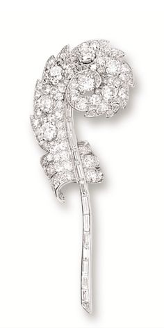 DIAMOND 'FEATHER' BROOCH, MOUNTED BY CARTIER, CIRCA 1930.  Modelled as a feather, set with old-cut and baguette diamonds together weighing approximately 10.00 carats, mounted in 18 karat white gold, signed Monture Cartier