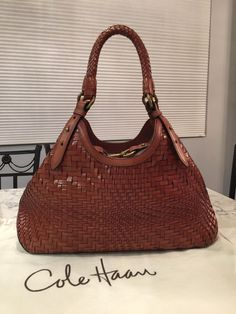 Cole Haan Genevieve Like New! Woven Leather Hobo Satchel Handbag Saddle Brown Cognac Tote Bag. Get one of the hottest styles of the season! The Cole Haan Genevieve Like New! Woven Leather Hobo Satchel Handbag Saddle Brown Cognac Tote Bag is a top 10 member favorite on Tradesy. Save on yours before they're sold out! GORGEOUS!!! MINT CONDITION!!! BEAUTIFUL SADDLE BROWN / COGNAC BROWN WOVEN LEATHER WEAVE BAG!!! SALE!!! WOW!!!