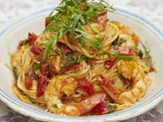 I'm going to add red peppers and make this tonight with all the prawns in my fridge waiting to be cooked! Looks super easy.