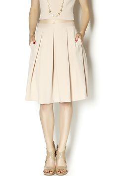 High-waisted fit & flare skirt. Feminine and flirty; pair with the matching crop top for a polished look.