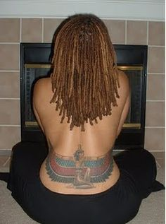 Maat tattoo on lower back <==LOVE her locs, and the tattoo is FLY! That's a LOT of work...beautiful