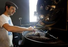 A small, but dedicated set of specialist cafes across Sydney are taking the business of coffee roasting into their own hands.