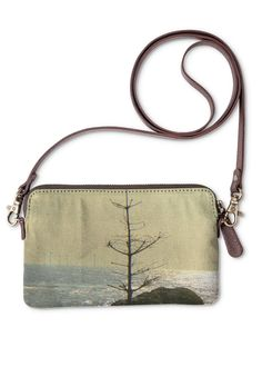 Lone Tree Statement Clutch: What a beautiful product! Carry it as a clutch or wear it as a purse - this art-infused canvas bag with removable leather strap is a standout accessory for any occasion.