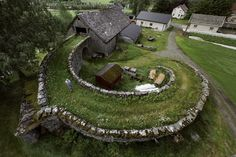 A barn in Norway This is a novel way to reach the hay loft! Plus, it creates a little microclimate in the middle: brilliant.