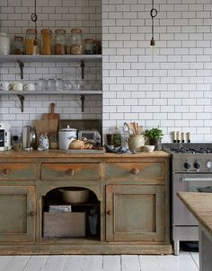 Here's a kitchen look that we can't get enough of: new kitchens that look old. If you love Shaker cabinets and soapstone counters and weathered woods and farmhouse sinks, you're in for a real treat.