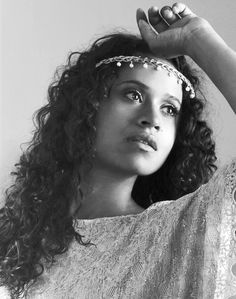 Angel Coulby; her physical beauty is often disputed. But, anyone who has seen this woman on screen cannot deny her grace, elegance, and presence. That's beauty to me.