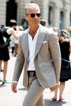 Shop this look on Lookastic: https://lookastic.com/men/looks/grey-suit-white-dress-shirt-white-pocket-square-dark-brown-sunglasses/10637   — Dark Brown Sunglasses  — White Dress Shirt  — White Pocket Square  — Grey Suit