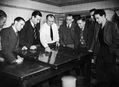 Arsenal manager Tom Whittaker demonstrating a plan on the tactics table