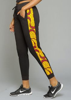 Binty Women 's African Print Side Stripe Jogger (gelb / rot wirbelt) – … - Druck Mode African Fashion Designers, African Inspired Fashion, Latest African Fashion Dresses, African Print Fashion, Africa Fashion, African Print Clothing, African Print Dresses, African Dress, African Prints